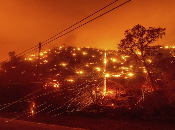 Embers burn along a hillside as the LNU Lightning Complex fires