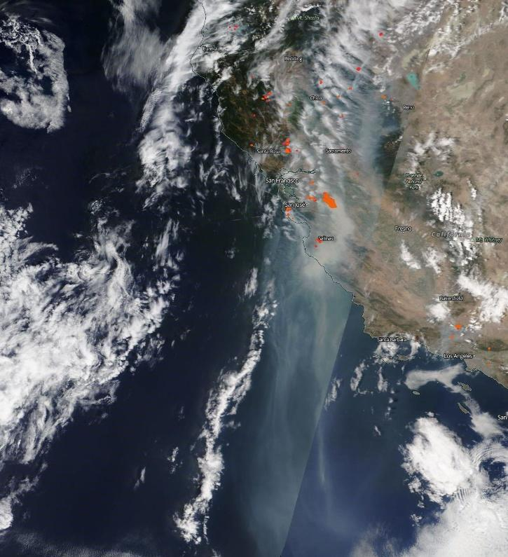 Copious clouds of smoke spill off the California coast and travel almost 600 miles in NASA
