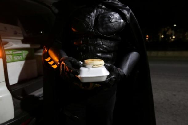 Batman carrying food