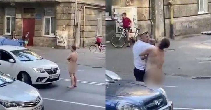 Naked man gets punched
