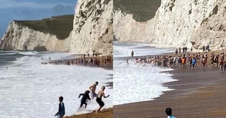 people rescue drowning man