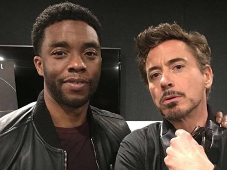 Robert Downey Jr and chadwick boseman.