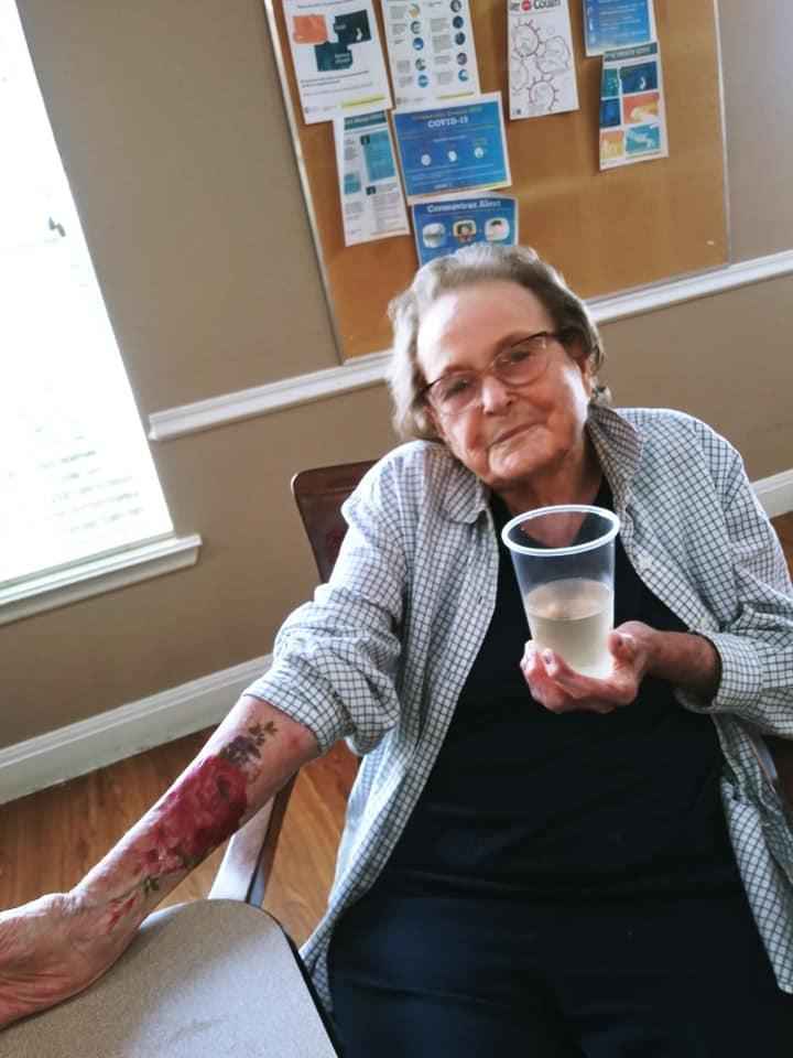 senior citizens getting temporary tattoos