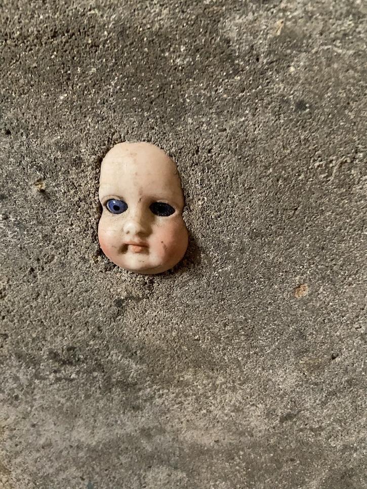Doll face basement wall