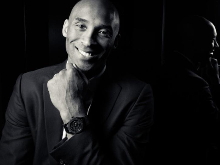 A black and white still of Kobe Bryant.