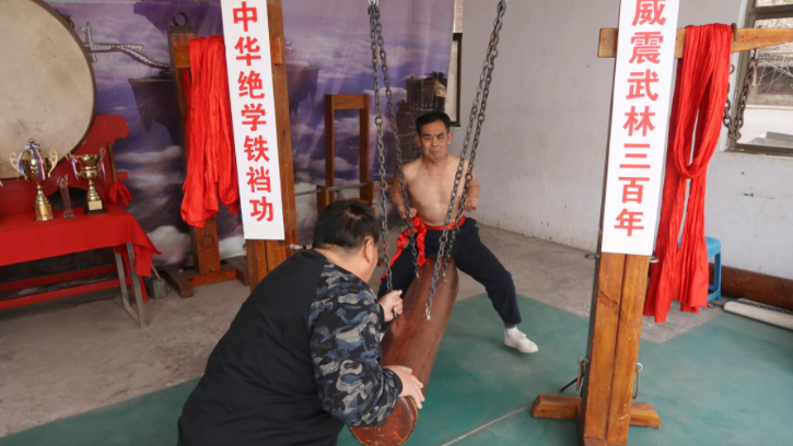 ang and his fellow masters started to actively promote their style of kung fu, adopting the swinging log device in 2016 to demonstrate the iron crotch technique
