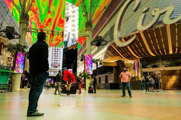 A 10-foot monolith is standing under the Fremont Street Experience canopy in downtown Las Vegas.