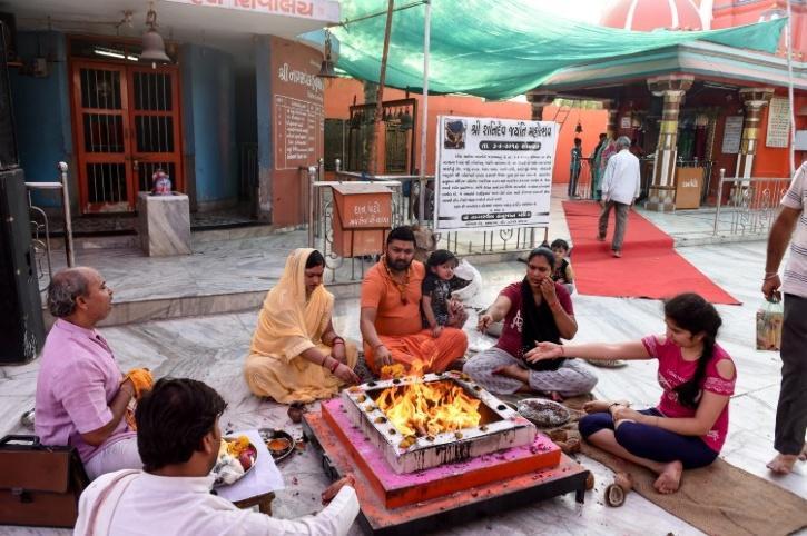 Priest performing puja