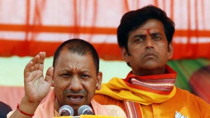 Ravi Kishan  with CM Aditya Yoginath / Agencies