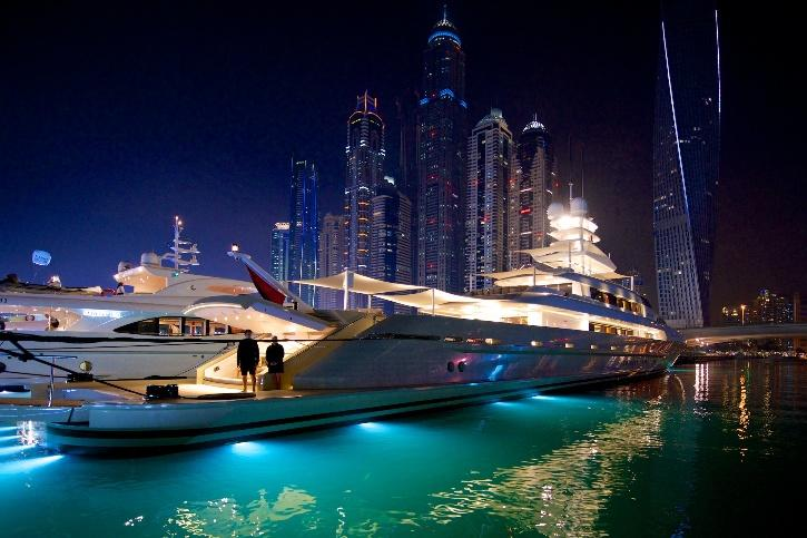All the birthday invitees had moved to the upper deck of the yacht that had started its route from Dubai Marina.