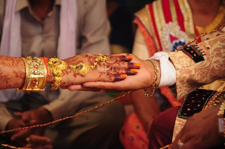 Bride injures back in accident, ties the knot in hospital