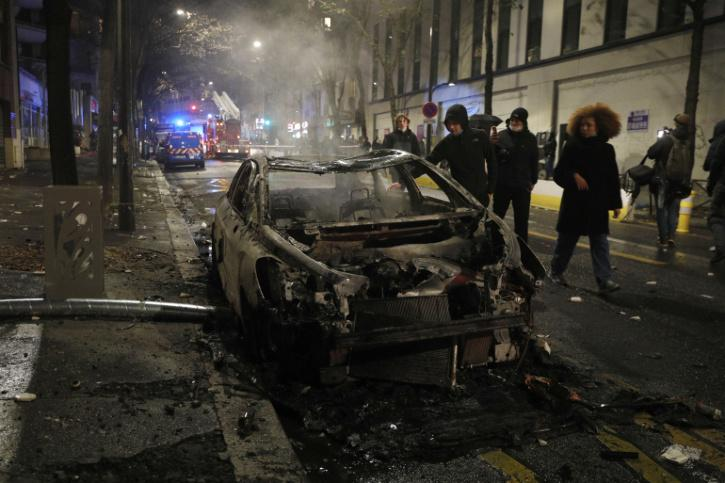 Violence erupted in Paris for the second consecutive weekend at a mass protest against a new security law and police brutality, as demonstrators clashed with police, set alight vehicles and smashed shop windows.  A largely peaceful march against the conte