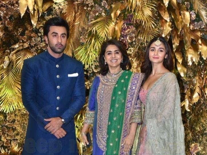 Alia Bhatt, Neetu Kapoor and Ranbir Kapoor at Armaan Jain and Anissa Malhotra's wedding reception.