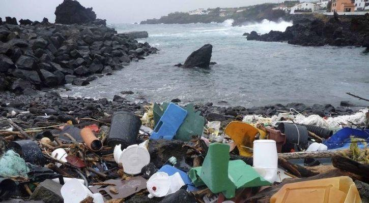 plastic waste lying discarded near the sea causing water pollution