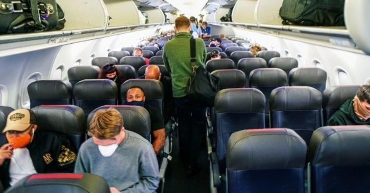 flight status COVID-19 middle seats plane