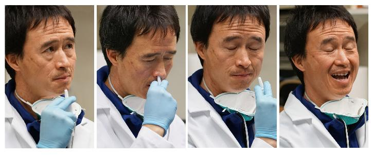 Don Wang administers a do-it-yourself nasal vaccine