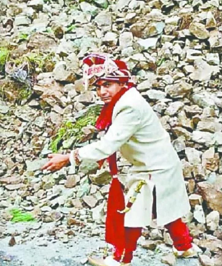 groom removing debris from road