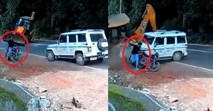 biker escapes as Bolero collides with jcb