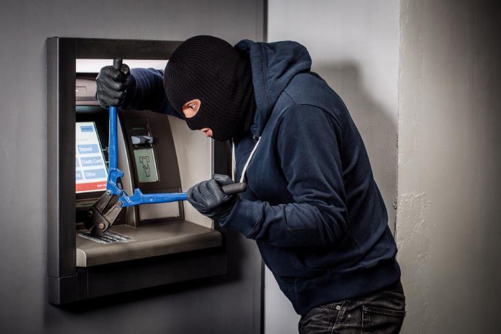 robber trying to break atm