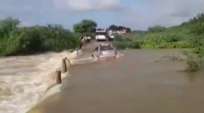 car getting washed away into stream