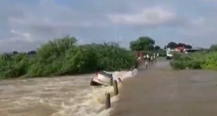 Car washed away into stream