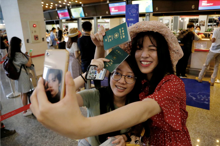 Girls taking selfie before fake flight in Taiwan