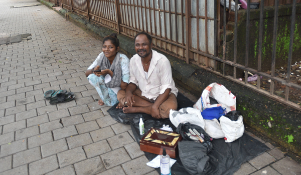 girl living on footpath with family clears class X
