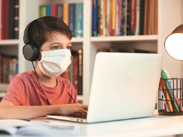 child taking online classes