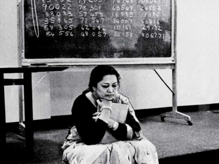 Shakuntala Devi solving complex mathematical problems on a blackboard.