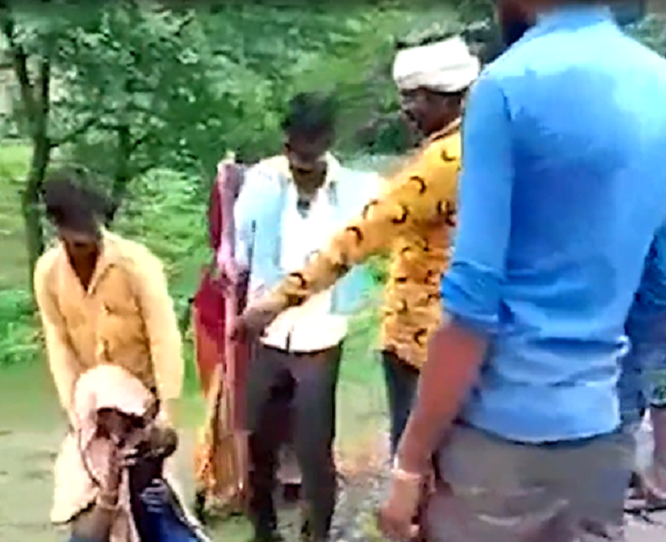 woman forced to carry husband on shoulders