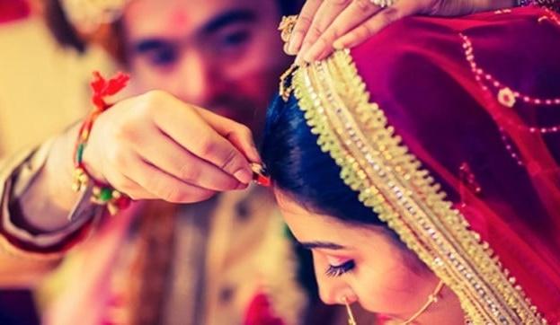 Woman wearing Sindoor during marriage
