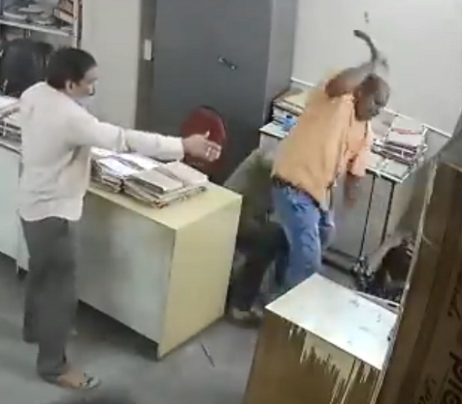 man hits woman with iron rod