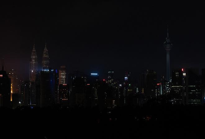 The Petronas Twin Towers and Kuala Lumpur Tower in Malaysia in Earth Hour 2020