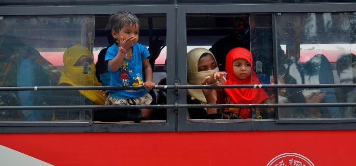 Desperate Migrants Take Arduous Journey Back Home