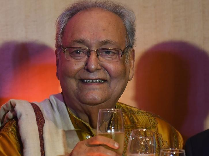 A smiling picture of Soumitra Chatterjee.