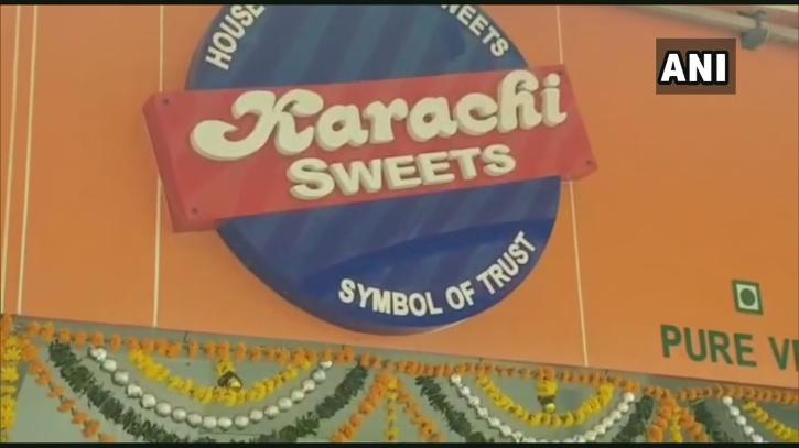 An owner of a sweets shop named Karachi Sweets in Mumbai had to hide his shop's name with newspapers