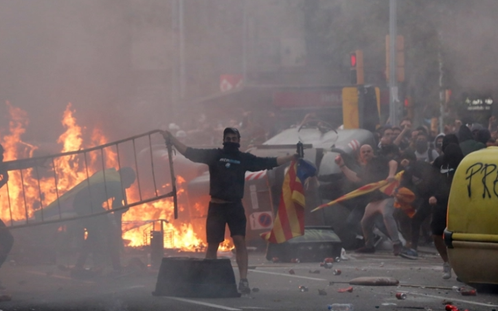 Masked demonstrators have clashed with police in central Barcelona