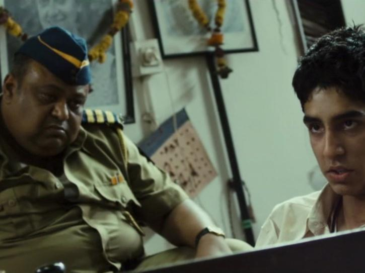 Saurabh Shukla as Constable Srinivas in Slumdog Millionnaire.