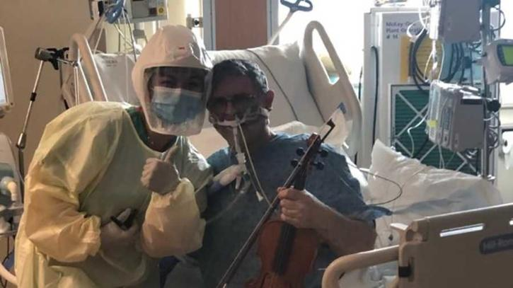 Ciara Sase, registered nurse, with Grover Wilhelmsen as his holds a musical instrument.