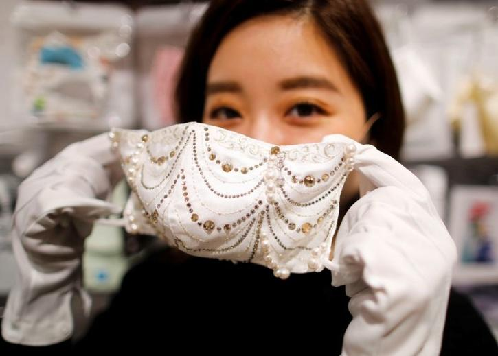 The diamond masks are embellished with a 0.7 carat diamond and more than 300 pieces of Swarovski