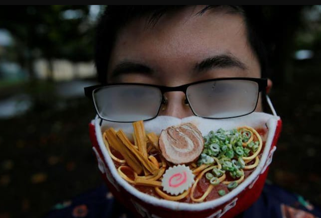 Japanese artist's mockery of glasses getting fogged because of his face masks,