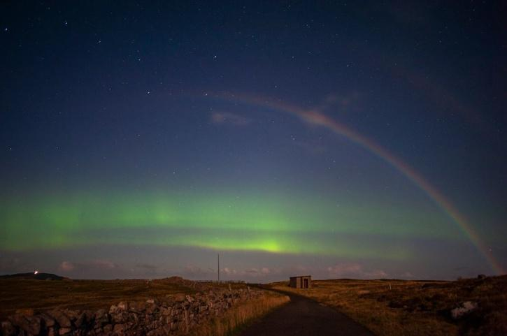 Moonbow and northern lights