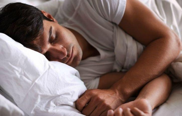 man asleep on bed
