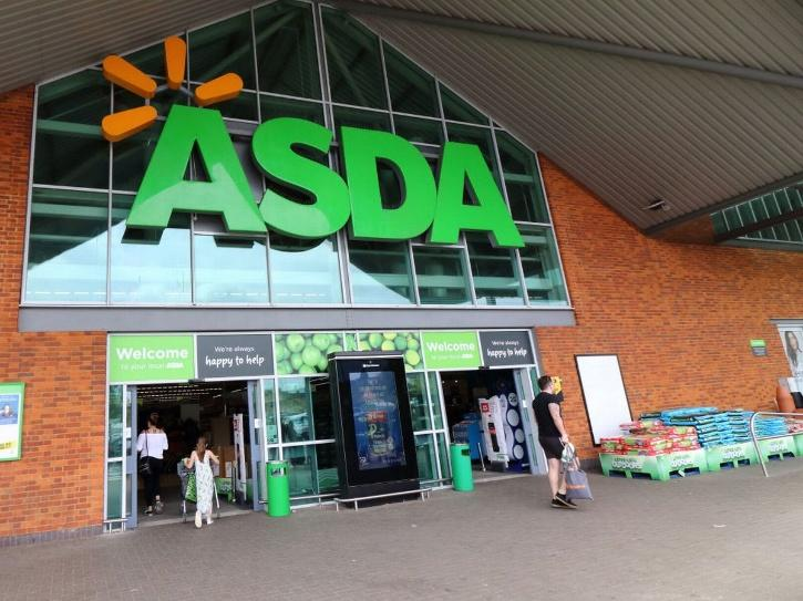 The new owners will invest more than 1 billion pounds in the next three years in Asda