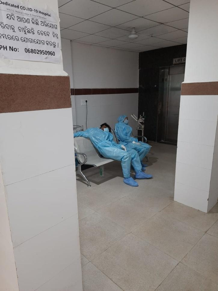 Exhausted nurses after a shift in a Dedicated Covid hospital in Odisha