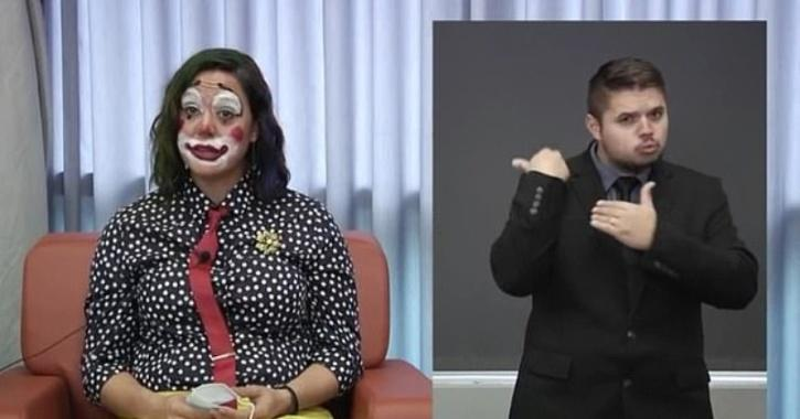 Claire Poche, a senior member of Oregon Health Authority, painted a big red smile across her face and wore a polka dot shirt with yellow trousers during the video announcement
