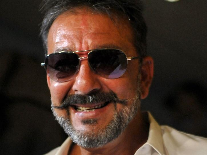 A still of Sanjay Dutt smiling in salt-and-pepper look.