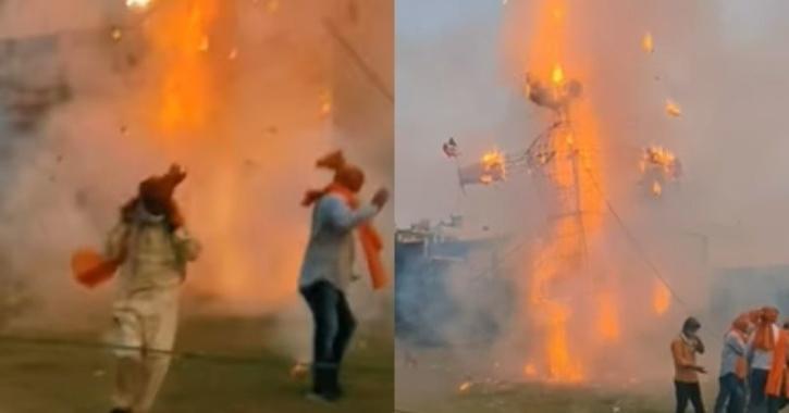 The video shows people walking towards the Ravanna effigy to set it ablaze.