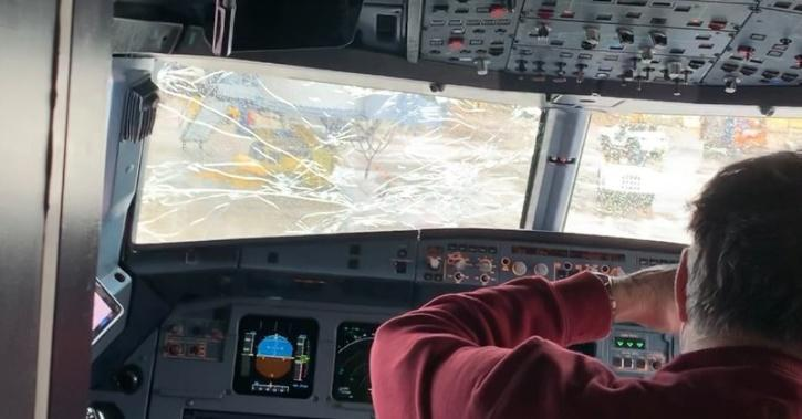 Alex Lang was on the flight, and issued a tweet that showed the cracked windshield.