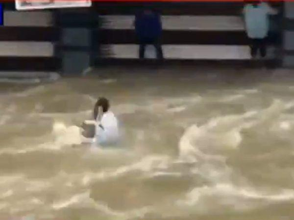 Floodwaters in  Hyderabad sweeps man away